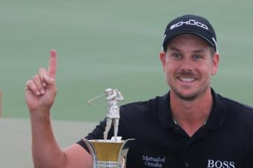 hi-res-450203541-henrik-stenson-of-sweden-poses-with-the-race-to-dubai_crop_north